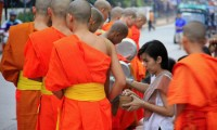 Alms giving in Laos