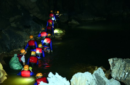 Swimming underground river in Dark cave