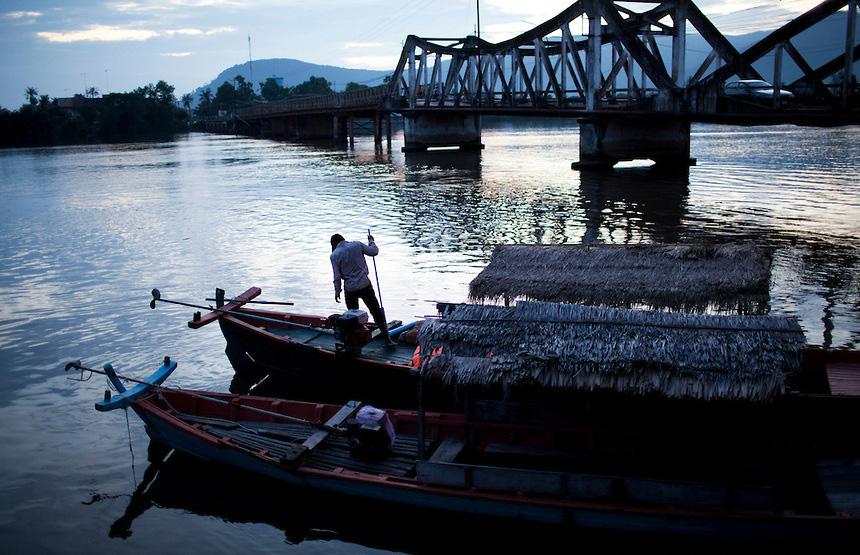 A boat docks in the Kampot river, in Kampot town, Cambodia.