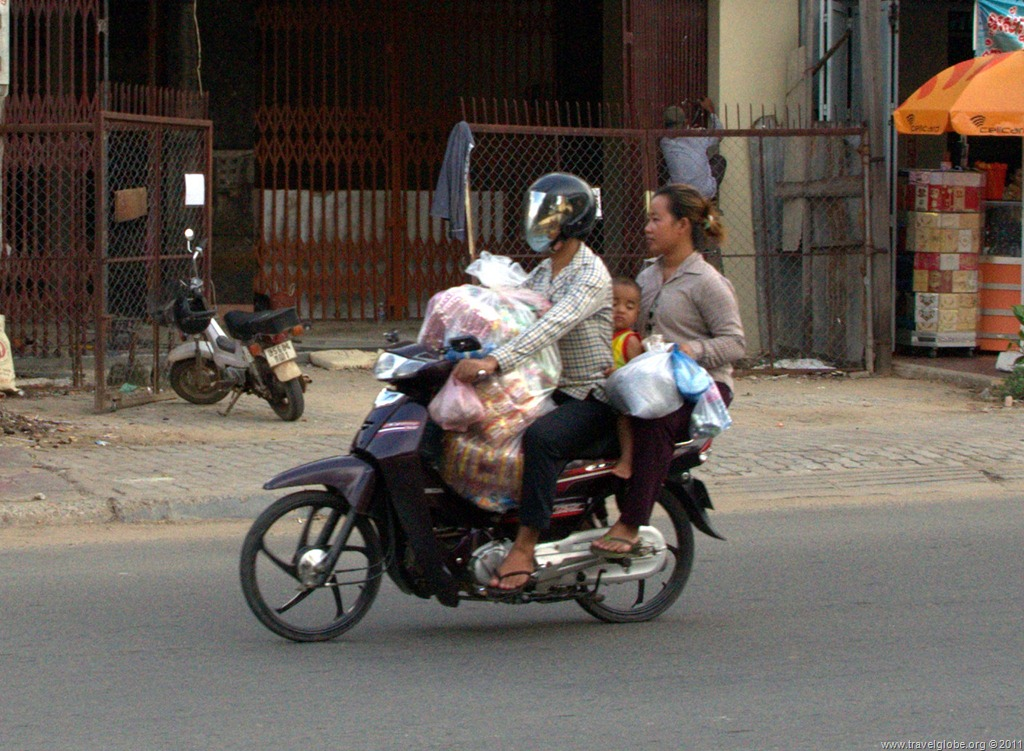 Baby and groceries on motorcycle in Phnom Penh, Cambodia
