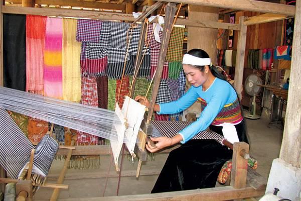 Brocade weaving in Mai Chau valley, Vietnam