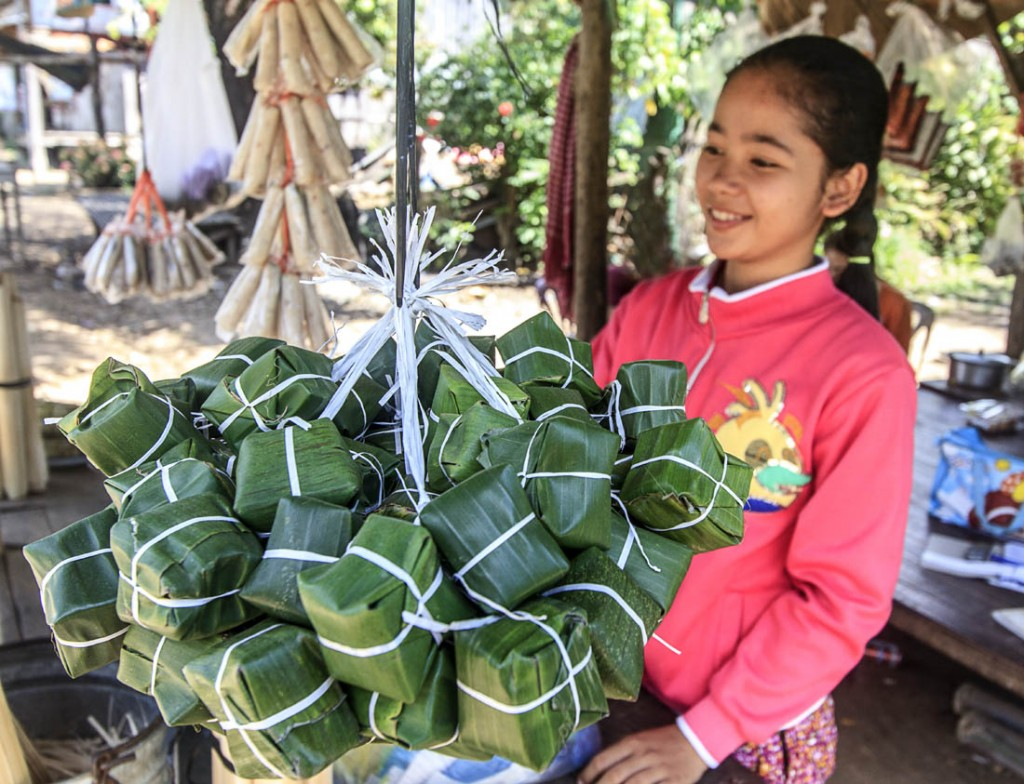 Cambodia young girl with sticky rice cakes