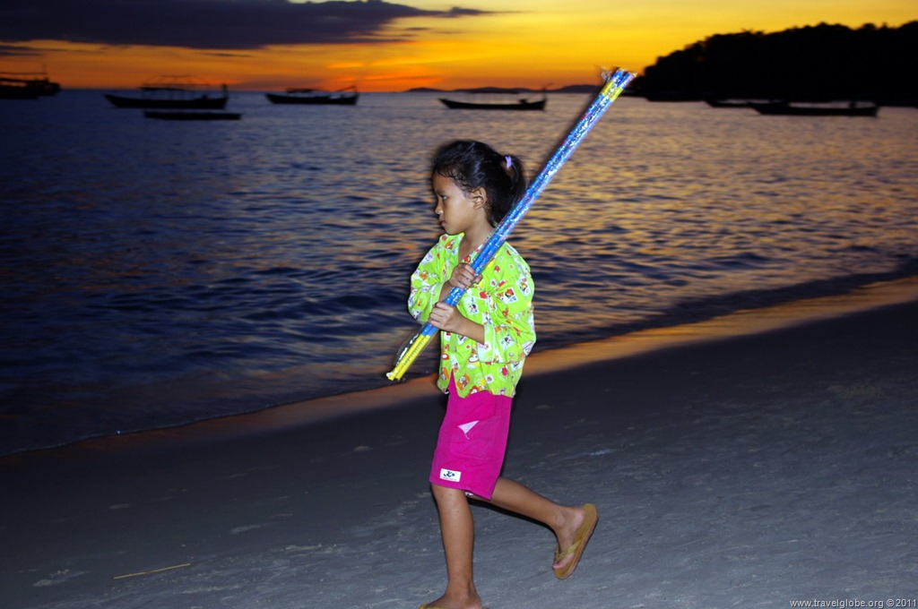 Child selling fireworks on the beach in Sihanoukville, Cambodia