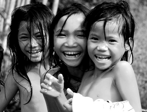 Radiant eyes of the young girls in Tay Tra highland district, Quang Ngai province