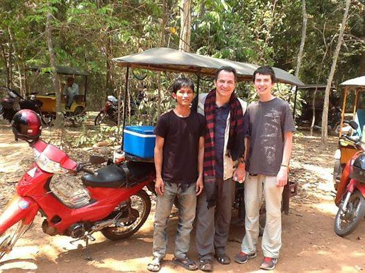 Getting around Angkor by tuk tuk, a traditional vehicle of Cambodian