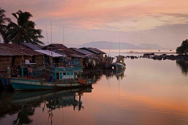 Sun sets on a small fishing village outside Kampot.