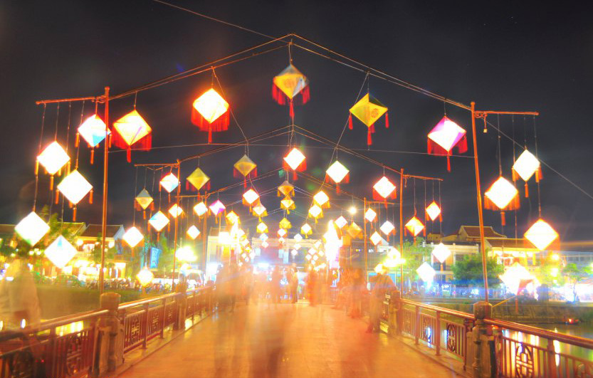 The nicely lit up bridge crossing over the river, Hoian
