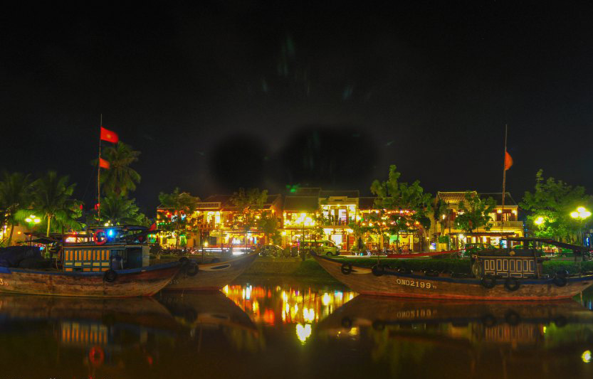 The river at night becomes a mirror for all the lights, Hoian