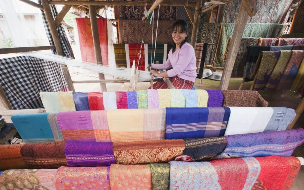 Woman weaving silk scarves, Ban Xang Hai Village, Luang Prabang, Laos