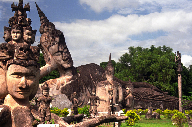 A statue of buddha lying leisurely in Centre of the park
