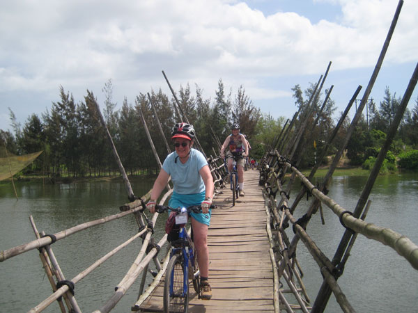 Cycling through  a bridge of Mekong Delta
