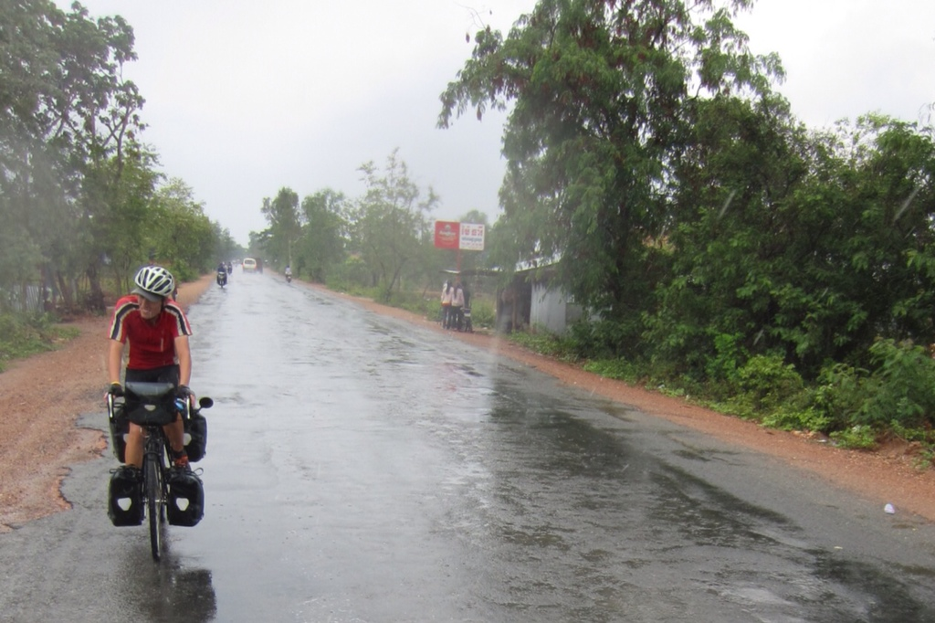 A man had his cycling trip in a wet day, Takeo province, Cambodia