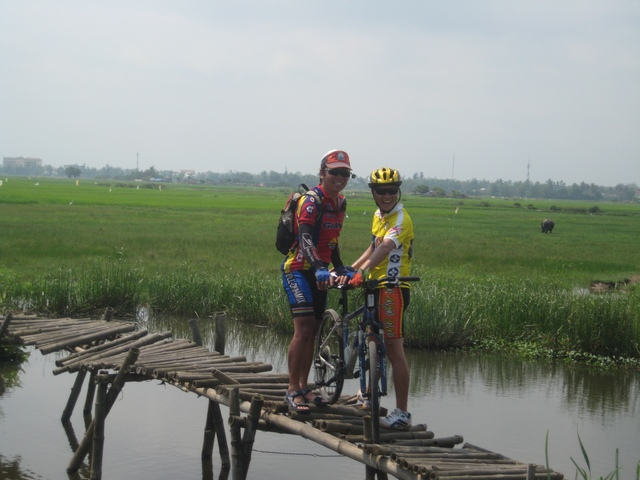 There are many bridges and roads near Mekong river on your cycling trip