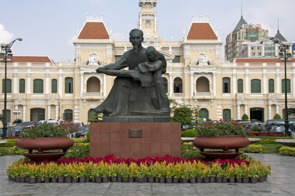 Statue of Ho Chi Minh and Peoples Committee Building in Ho Chi Minh city, Vietnam