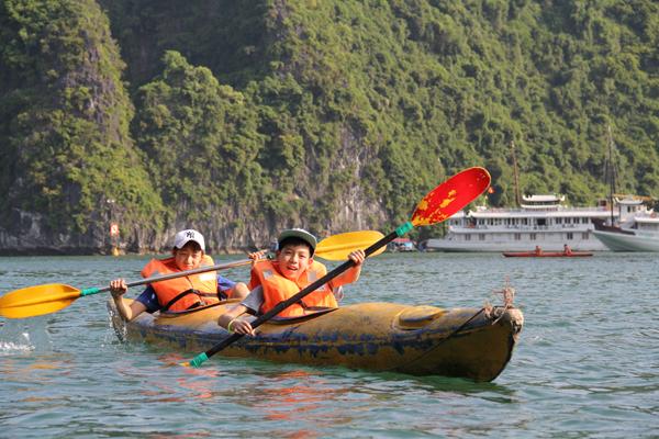 Children kayaking in Halong Bay