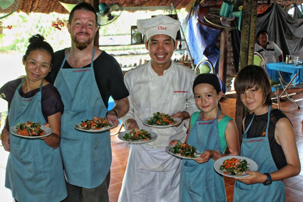 Family members cook together in Vietnam cooking class