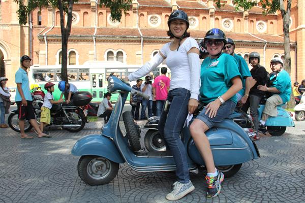 Visitors on Vespa before Ho Chi Minh City tour