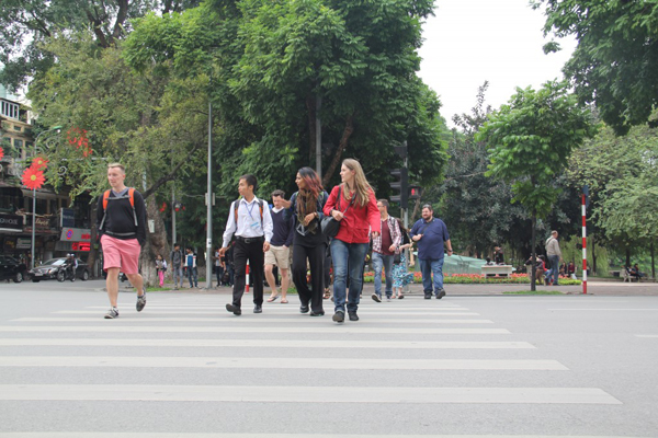 "The guide will take you through the windy streets of Hanoi help your cross"" the crazy traffics"""