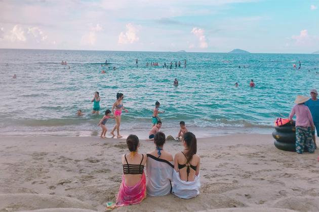 Bathing in the flawless Cua Dai beach