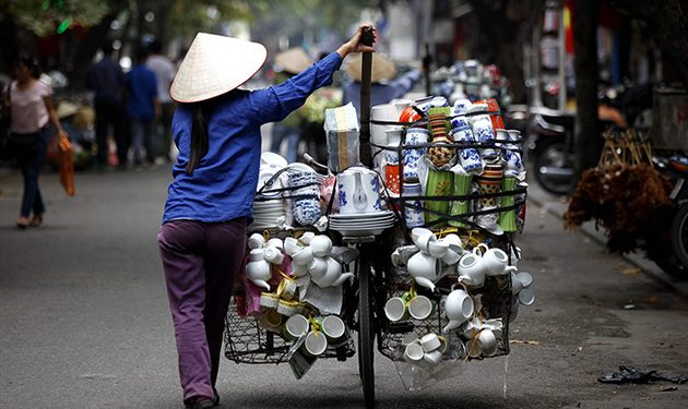 Ceramic vendor walking on the street of Hanoi