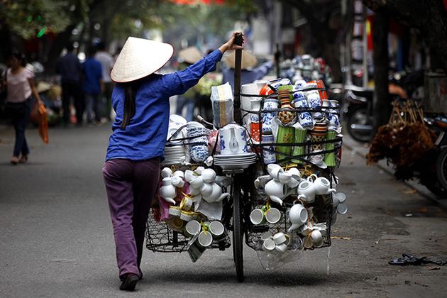 Ceramic vendor walking on the street of Hanoi