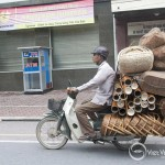 A men carry fish traps on the street of Hanoi