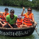 family on bamboo basket boat in Hoi An