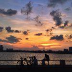 sunset at west lake in hanoi