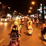 Along the hustling and bustling streets of saigon at Night on the back of Vespa