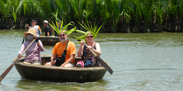 Board a rounded bamboo basket boat and learn how to paddle this traditional boat of the local