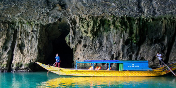 Boat trip along the river to access Phong Nha Cave