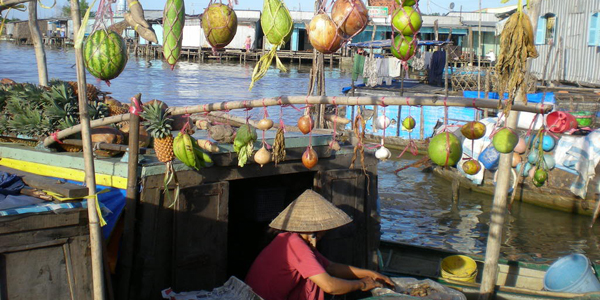 A fruit seller in Cai Rang Floating Market