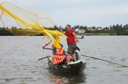 Casting fishing net from rounded bamboo boat