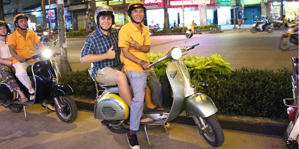 Discover Saigon afer dark on the back of Vespa