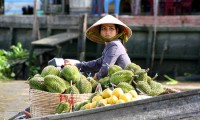 Fruit seller in Cai Be Floating Market of mekong delta