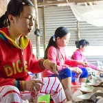 See the local making rice papers at their workshop
