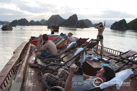 Sun set in Halong bay the group is relaxing after kayaking