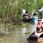 Take a boat trip to discover the waterways of Mekong Delta