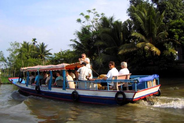 a boat trip at canals in mekong delta