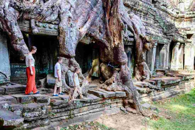 a family visits angkor wat complex