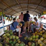 enjoy coconut juice at cai be floating market