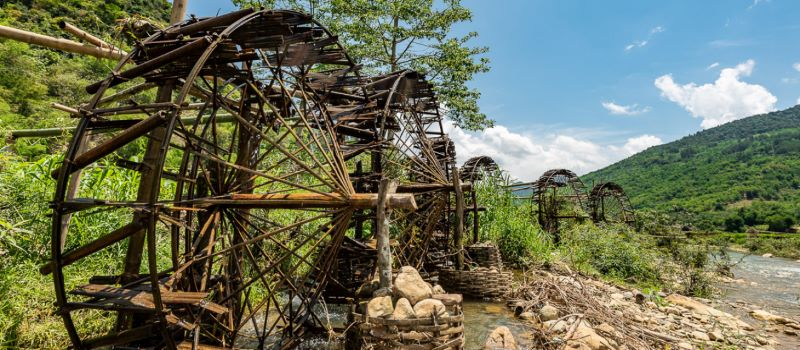 giant wooden wheels in pu luong nature reserve