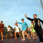 halong bay tai chi exercise in the morning
