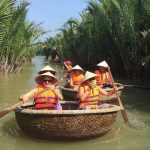 hoi an basketball bamboo boat along palm waterway