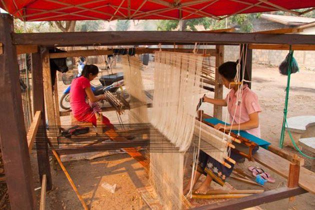 local women weaving in ban phanom village