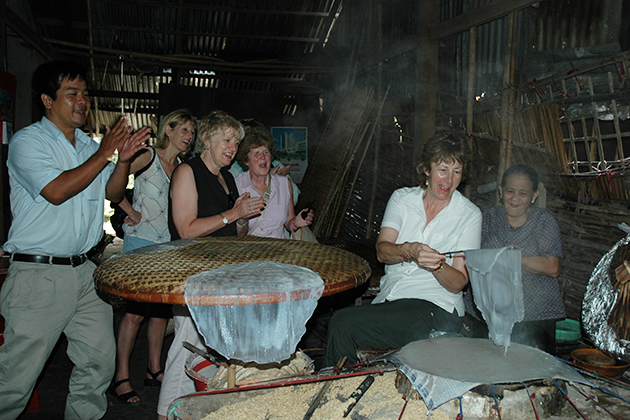 making rice paper at mekong delta indochina tour package