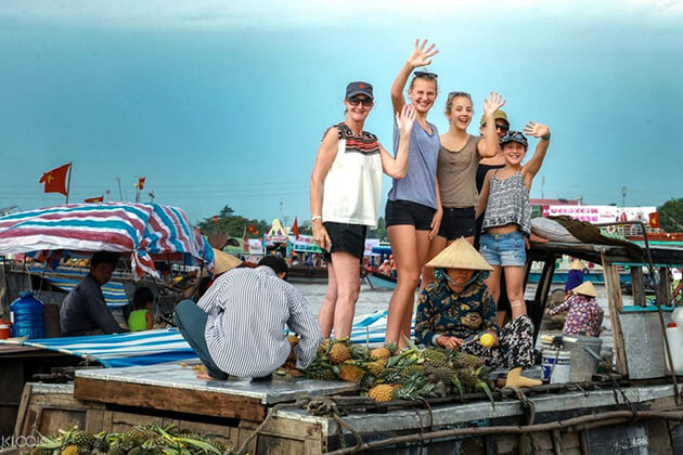 mekong delta family tour at cai be floating market