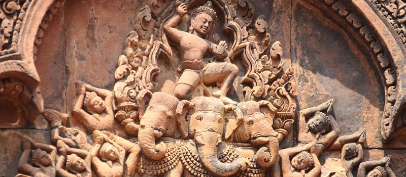 sculpture in angkor wat cambodia and north to south vietnam tour