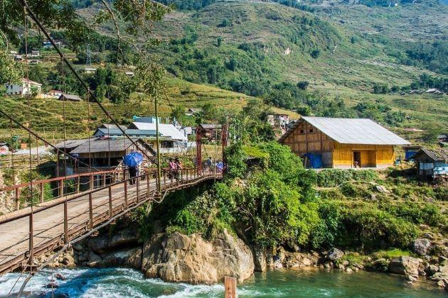 the bridge leads to a sapa local village