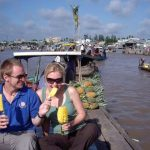 visit cai be floating market by boat
